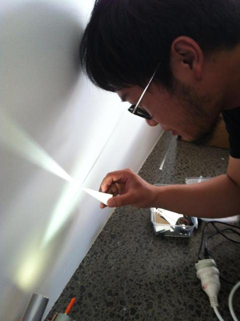 Alvin Xiong installing at Corner; photo courtesy of the artist