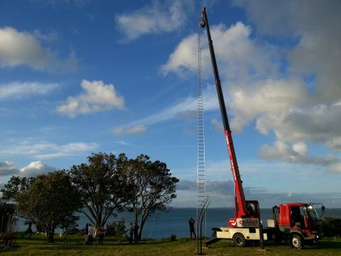 Installing Gary Smith's Really High!? 2012, NZ Sculpture OnShore 2012; photo by Rob Garrett