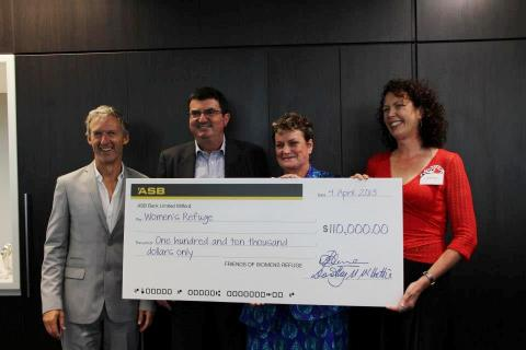 Rob Garrett, Erich Bachmann, Heather Henare, Alix Bachmann with the presentation of $110,000 to Women's Refuges of New Zealand; photo courtesy of Hesketh Henry
