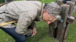 Rob Garrett listening to Sharonagh Montrose's sound project at NZ Sculpture OnShore 2014; photo courtesy of Rob Garrett