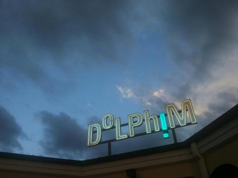 Twilight at NZ Sculpture OnShore with Paul Hartigan's new neon work DoLPhiM