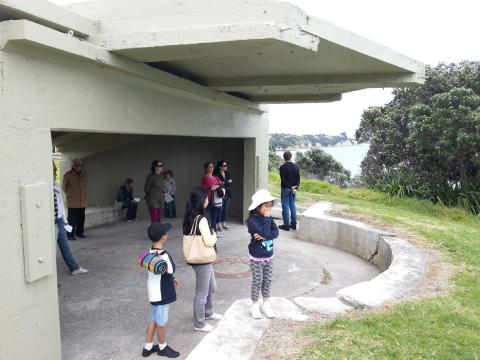 Visitors listening to Sharonagh Montrose's My Small Corner at NZ Sculpture OnShore