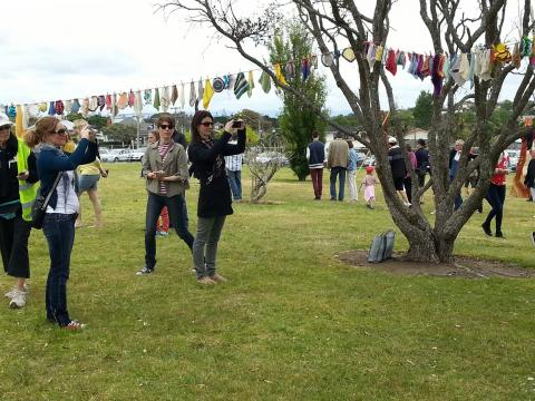 Visitors to NZ Sculpture OnShore enjoying Madpanic Collective's bunting project